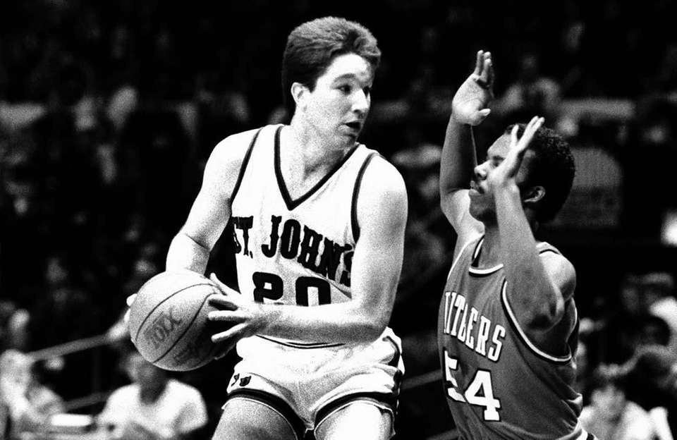 St. John's University's Chris Mullin hangs onto a