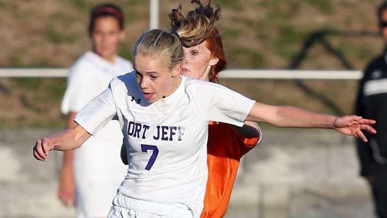 Port Jefferson's Jillian Colucci fights for the ball