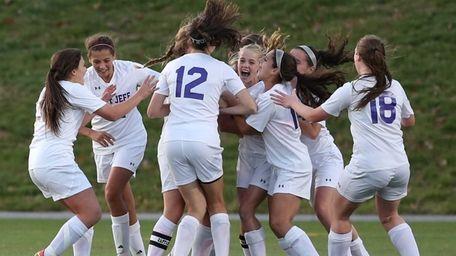 Port Jefferson's Jillian Colucci #7 celebrates with teammates