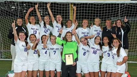 Port Jefferson poses with the team trophy after