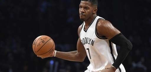 Brooklyn Nets forward Joe Johnson looks to pass