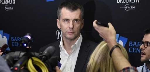 Brooklyn Nets owner Mikhail Prokhorov speaks to the