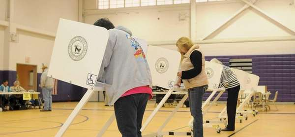 Voters cast their ballots shortly after the polls