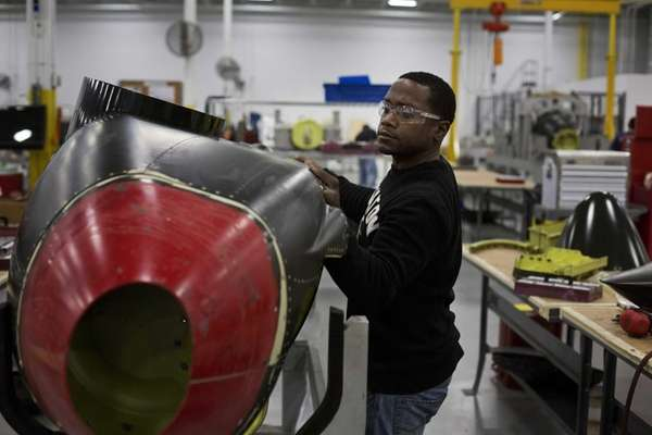 A CPI Aerostructures worker makes aircraft parts on