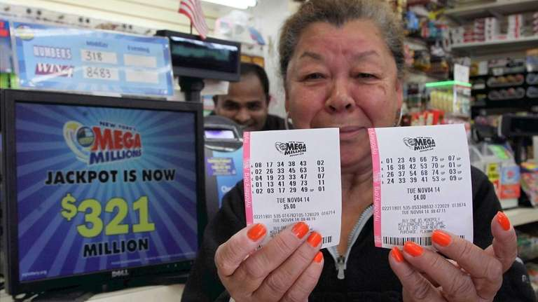 Eva Munoz of Freeport holds up her just-purchased
