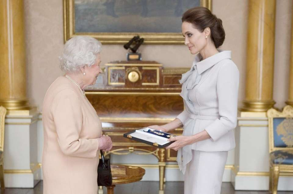 Angelina Jolie is presented with the Insignia of