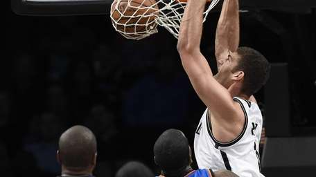 Brooklyn Nets center Brook Lopez dunks against the