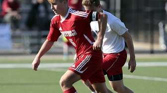 Southold's Sean Moran advances the ball ahead of
