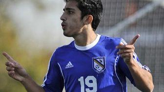 Mattituck's Kaan Ilgin reacts after scoring a goal