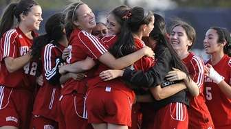Wheatley teammates celebrate after their 1-0 win over