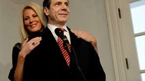 Gov. Andrew M. Cuomo stands with his girlfriend