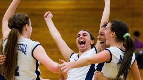 Massapequa players cheer after defeating Baldwin in the