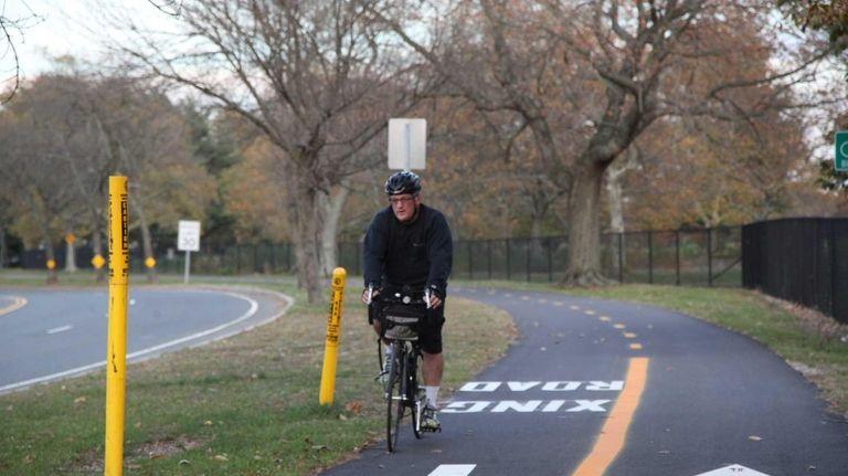 A bicyclist rides on the Vanderbilt trail running