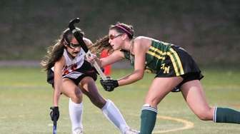 Ward Melville's Katie Koester shoots the ball while