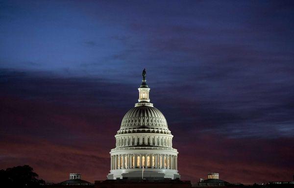 U.S. Capitol dome at sunrise over Washington, DC
