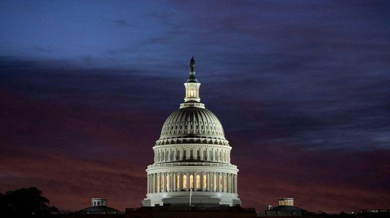 U.S. Capitol dome at sunrise over Washington, D.C.,