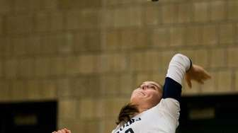 Baldwin's Keira Knauer (10) serves against Massapequa in