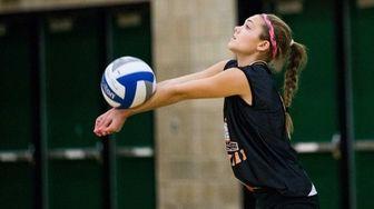 East Rockaway's Marisa Felbinger bumps the ball against