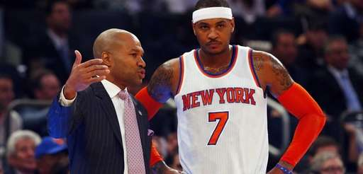 Derek Fisher of the Knicks talks with Carmelo