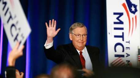 Sen. Mitch McConnell (R-Ky.) greets supporters during his