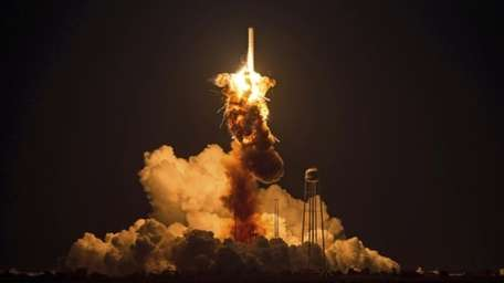 The Orbital Sciences Corp. Antares rocket carrying the