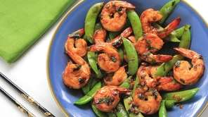 Seared shrimp is tossed with sugar snaps and