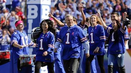 The Buffalo Bills' new owners, Kim, left, and