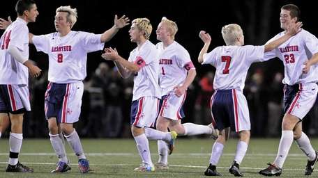 MacArthur teammates celebrate after a goal by No.