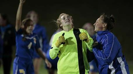 West Islip keeper Cali Loeffler reacts after defeating