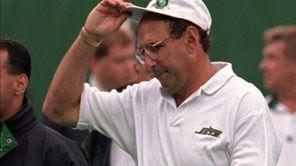Jets head coach Rich Kotite walks off the