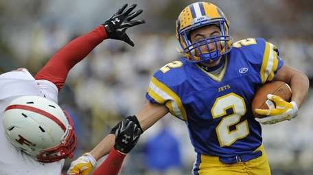 East Meadow running back Billy Piano shrugs off