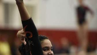 Babylon's Alex Singleton performs the floor exercise in