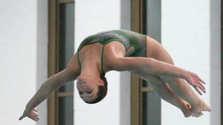 Grace Reeves of Lindenhurst dives during the Suffolk