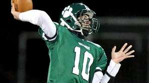 Lindenhurst QB Ryan Hofmann looks to pass against