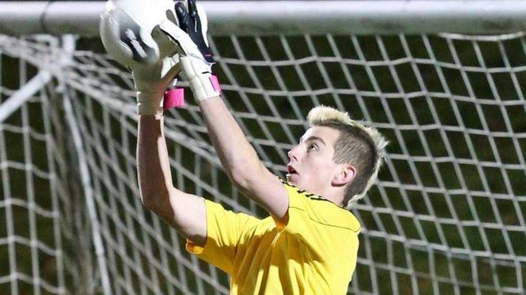Commack goalie Ryan Sinnott makes a save late