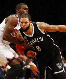 Deron Williams of the Nets drives to the