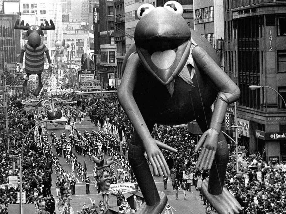 Bullwinkle trails Kermit the Frog along Broadway in