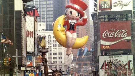 Betty Boop soars through Times Square during the