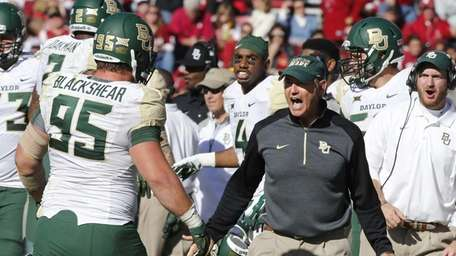 Baylor head coach Art Briles celebrates on the