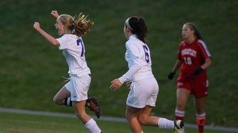 Port Jefferson forward Jillian Colucci celebrates after scoring