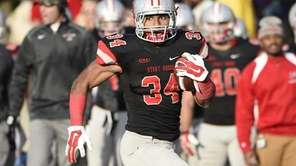 Stony Brook Seawolves running back Marcus Coker gains