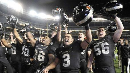 Army quarterback Angel Santiago, Larry Dixon , and