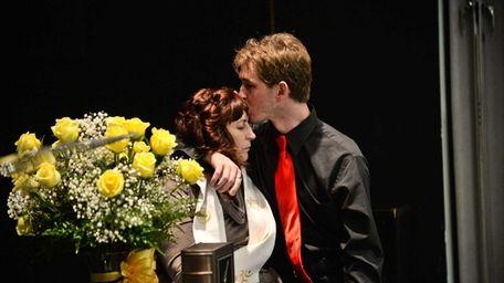 Griffin Roche-Tilden, son of James Tilden, kisses his
