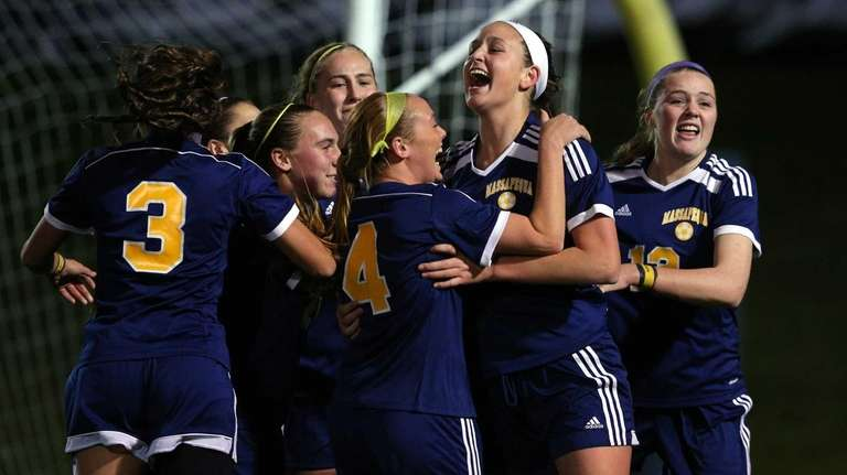 Massapequa's Melanie Hingher celebrates her first goal against