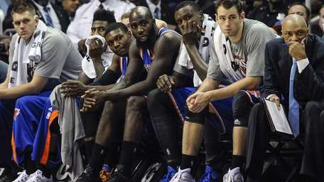 New York Knicks players and coaches watch from