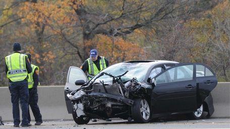 Suffolk County police investigators probe a fatal crash