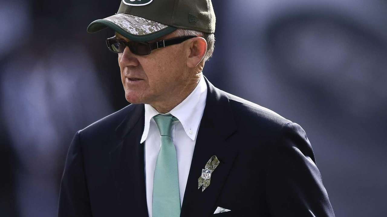 New York Jets owner Woody Johnson looks on