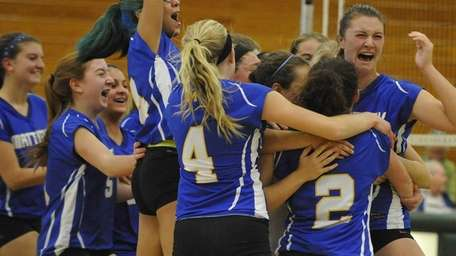 Mattituck players celebrate after their 3-0 win over