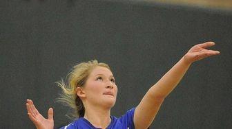Mattituck's Lizzie Wilcenski serves during the third set