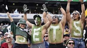 Jets fans celebrate during the second half of